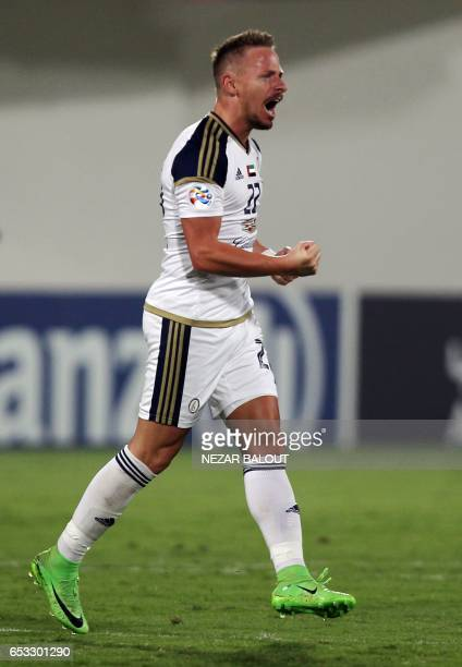 AlWahda's Balazs Dzsudzsak celebrates after scoring during the AFC Champions League group D football match between UAE's AlWahda and Saudi Arabia's...