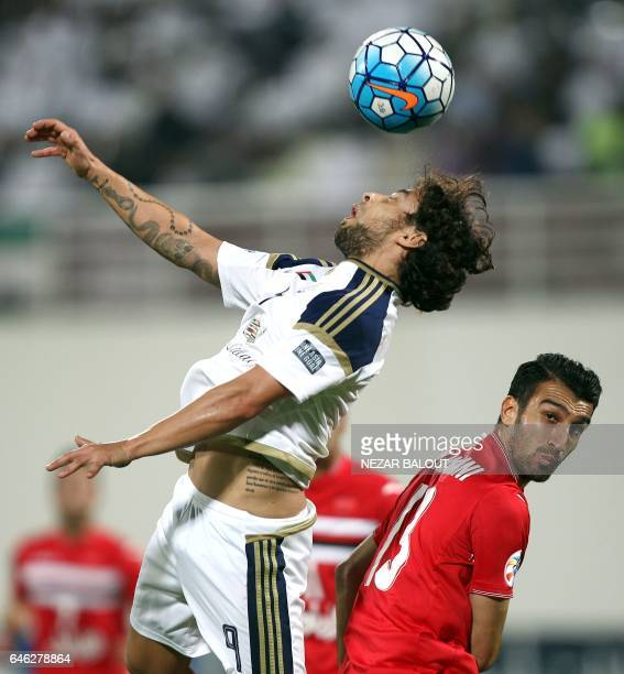 AlWahda's Jorge Valdivia fights for the ball against Persepolis's Vahid Amiri during the AFC Champions League qualifying football match between UAE's...