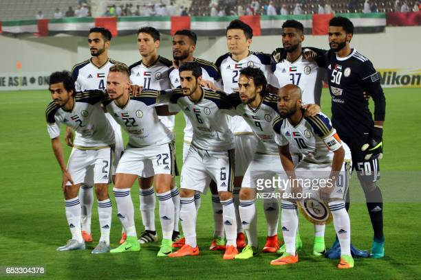 AlWahda's players pose prior to the AFC Champions League group D football match between UAE's AlWahda and Saudi Arabia's AlHilal at AlNahyan Stadium...