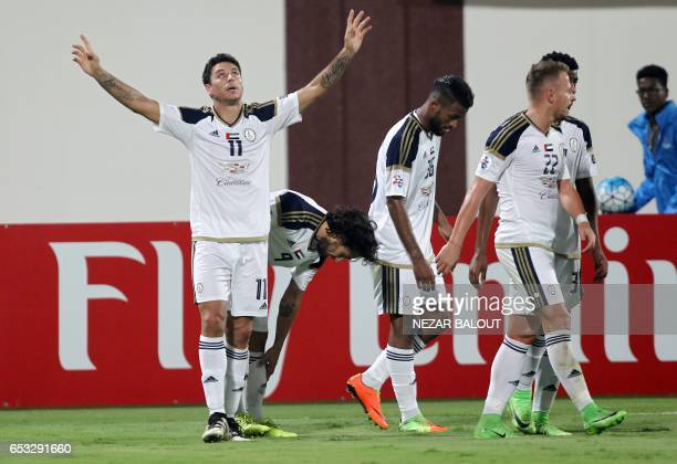 AlWahda's Sebastian Tagliabue celebrates after scoring during the AFC Champions League group D football match between UAE's AlWahda and Saudi...