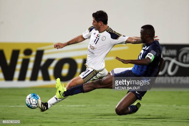 AlWahda's Sebastian Tagliabue fights for the ball against AlHilal's Osama Hawsawi during the AFC Champions League group D football match between...