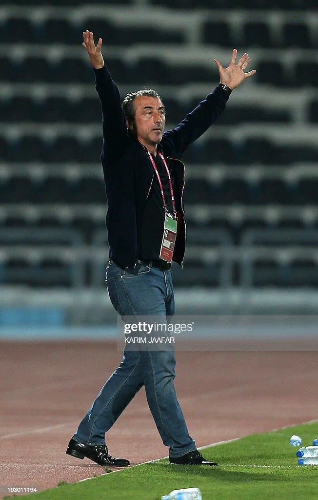 Al-Wakra football club's Bosnian coach Mehmed Bazdarevic gestures to his players during the Qatar Stars League football match in Doha on March 3, 2013. Al-Jaish won 1-0. AFP PHOTO/AL-WATAN DOHA/KARIM JAAFAR == QATAR OUT ==