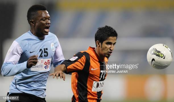 AlWakra's Congolese midfielder Tresor Kangambu challenges Umm Salal's Hamud alYazidi during their Qatar Stars League football match in Doha on...