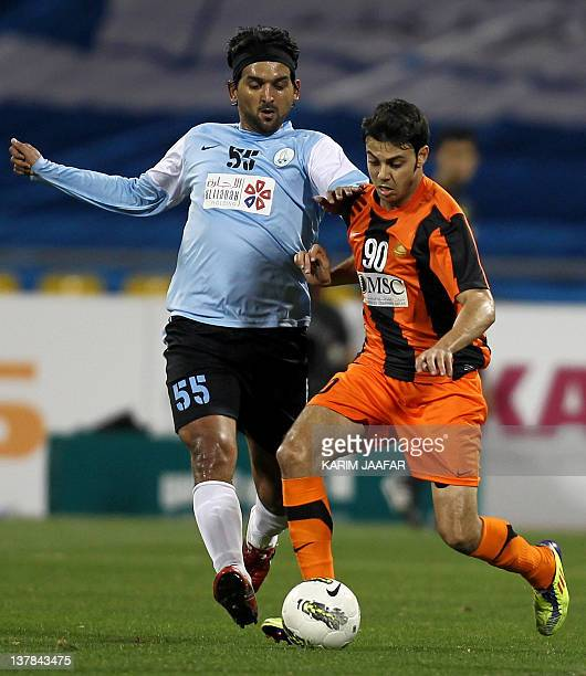 AlWakra's Iraqi midfielder Nashat Akram challenges Umm Salal's Rami Fayez during their Qatar Stars League football match in Doha on January 28 2012...