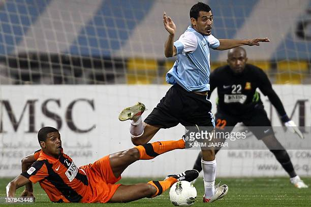 AlWakra's Iraqi striker Yunes Mahmud challenges Umm Salal's Bahraini defender Mohammed Hussein during their Qatar Stars League football match in Doha...