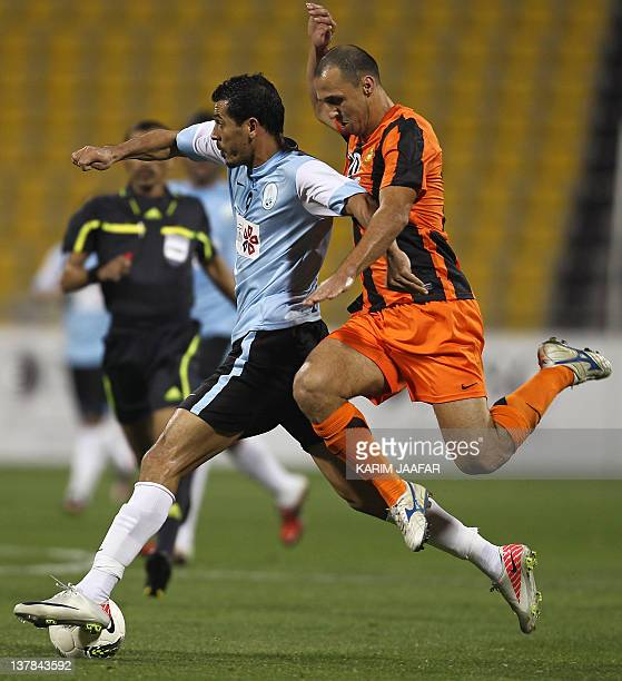 AlWakra's Iraqi striker Yunes Mahmud challenges Umm Salal's Jawad Ahnash during their Qatar Stars League football match in Doha on January 28 2012...