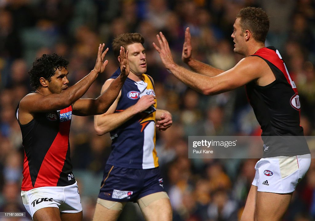 Alwyn Davey and Tom Bellchambers of the Bombers celebrate a goal during the round 14 AFL match between the West Coast Eagles and the Essendon Bombers at Patersons Stadium on June 27, 2013 in Perth, Australia.