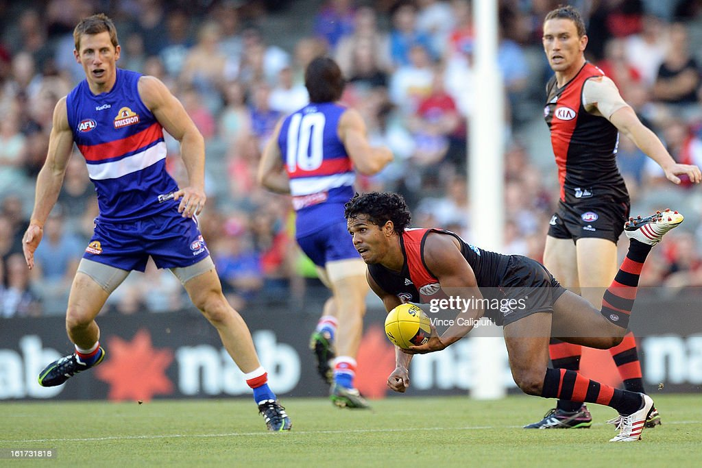 Alwyn Davey of the bombers looks to pass the ball during the round one AFL NAB Cup match between the Essendon Bombers and the Western Bulldogs at Etihad Stadium on February 15, 2013 in Melbourne, Australia.