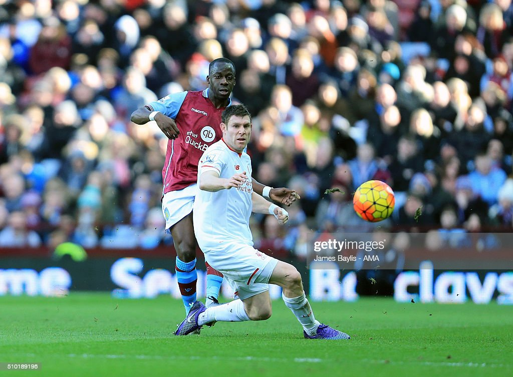 Aly Cissokho of Aston Villa and James Milner of Liverpool during the Barclays Premier League match between Aston Villa and Liverpool at Villa Park on February 14, 2016 in Birmingham, England.