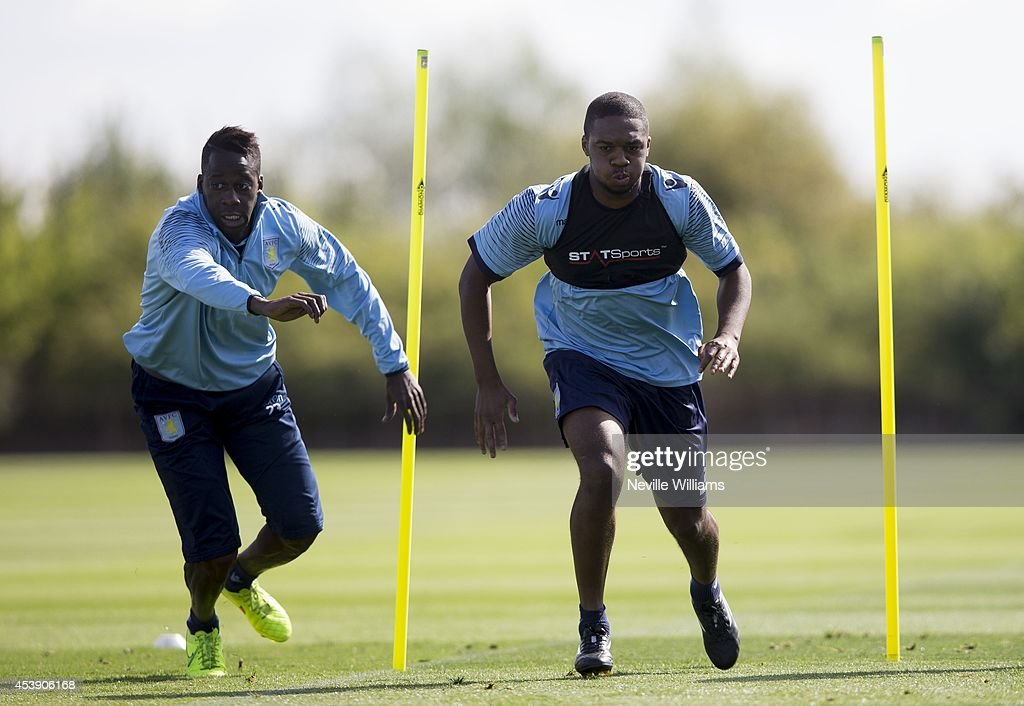 <a gi-track='captionPersonalityLinkClicked' href=/galleries/search?phrase=Aly+Cissokho&family=editorial&specificpeople=4302605 ng-click='$event.stopPropagation()'>Aly Cissokho</a> of Aston Villa in action with team mate <a gi-track='captionPersonalityLinkClicked' href=/galleries/search?phrase=Charles+N%27Zogbia&family=editorial&specificpeople=639159 ng-click='$event.stopPropagation()'>Charles N'Zogbia</a> during a Aston Villa training session at the club's training ground at Bodymoor Heath on August 21, 2014 in Birmingham, England.