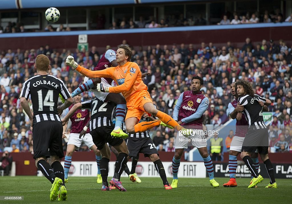 Aly Cissokho of Aston Villa is challenged by Tim Krul of Newcastle United during the Barclays Premier League match between Aston Villa and Newcastle United at Villa Park on August 23, 2014 in Birmingham, England.