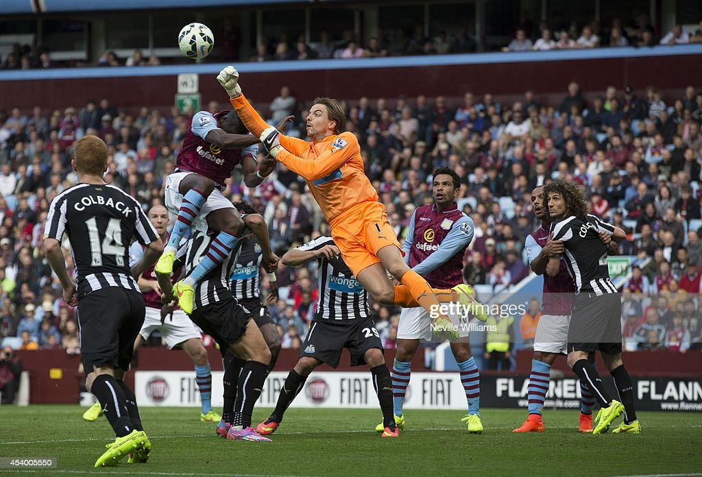 <a gi-track='captionPersonalityLinkClicked' href=/galleries/search?phrase=Aly+Cissokho&family=editorial&specificpeople=4302605 ng-click='$event.stopPropagation()'>Aly Cissokho</a> of Aston Villa is challenged by <a gi-track='captionPersonalityLinkClicked' href=/galleries/search?phrase=Tim+Krul&family=editorial&specificpeople=618004 ng-click='$event.stopPropagation()'>Tim Krul</a> of Newcastle United during the Barclays Premier League match between Aston Villa and Newcastle United at Villa Park on August 23, 2014 in Birmingham, England.