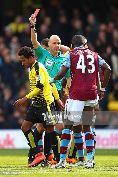 Aly Cissokho of Aston Villa is shown a red card by referee Anthony Taylor during the Barclays Premier League match between Watford and Aston Villa at...