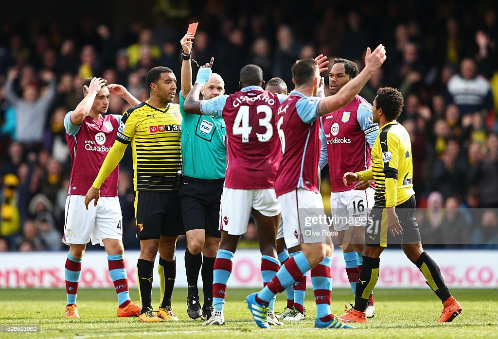 Aly Cissokho of Aston Villa is shown a red card by referee Anthony Taylor during the Barclays Premier League match between Watford and Aston Villa at Vicarage Road on April 30, 2016 in Watford, England.
