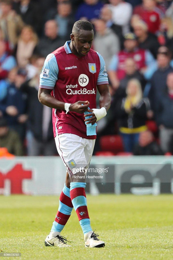 Aly Cissokho of Aston Villa walks off the pitch after receiving the red card during the Barclays Premier League match between Watford and Aston Villa at Vicarage Road on April 30, 2016 in Watford, England.