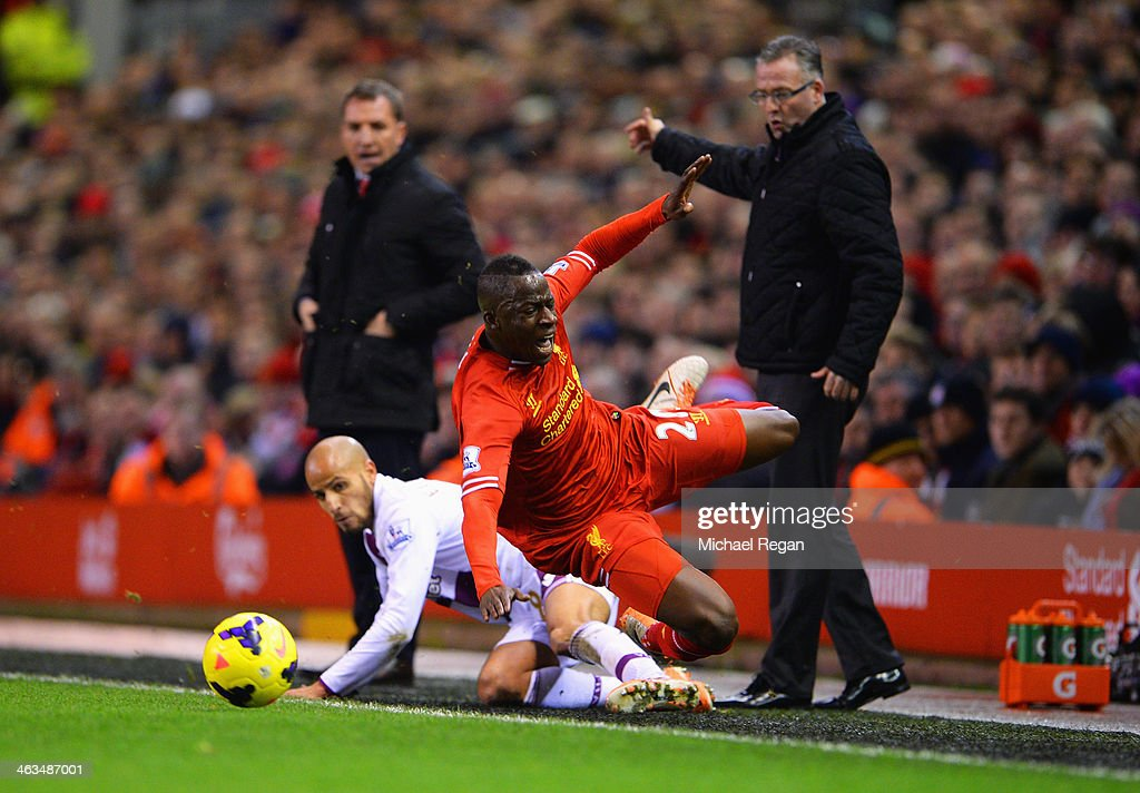 <a gi-track='captionPersonalityLinkClicked' href=/galleries/search?phrase=Aly+Cissokho&family=editorial&specificpeople=4302605 ng-click='$event.stopPropagation()'>Aly Cissokho</a> of Liverpool is challenged by <a gi-track='captionPersonalityLinkClicked' href=/galleries/search?phrase=Karim+El+Ahmadi&family=editorial&specificpeople=2345993 ng-click='$event.stopPropagation()'>Karim El Ahmadi</a> of Aston Villa during the Barclays Premier League match between Liverpool and Aston Villa at Anfield on January 18, 2014 in Liverpool, England.