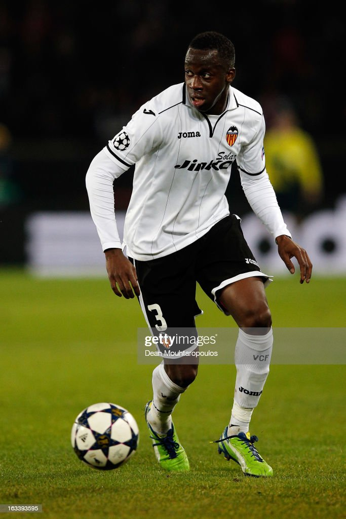 <a gi-track='captionPersonalityLinkClicked' href=/galleries/search?phrase=Aly+Cissokho&family=editorial&specificpeople=4302605 ng-click='$event.stopPropagation()'>Aly Cissokho</a> of Valencia in action during the Round of 16 UEFA Champions League match between Paris St Germain and Valencia CF at Parc des Princes on March 6, 2013 in Paris, France.