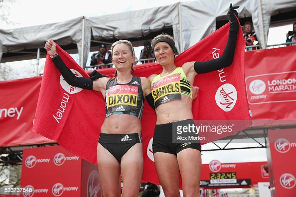 Aly Dixon of Great Britain and Sonia Samuels of Great Britain pose after the Virgin Money Giving London Marathon at the finish on The Mall on April...