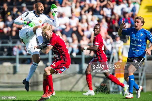 Aly Keita goalkeeper of Ostersunds FK and Curtis Edwards of Ostersunds FK during the Allsvenskan match between Ostersunds FK and Halmstad BK at...