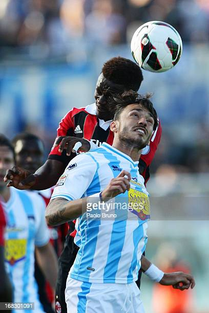 Aly Sulley Muntari of AC Milan competes for the ball with Emmanuel Cascione of Pescara during the Serie A match between Pescara and AC Milan at...