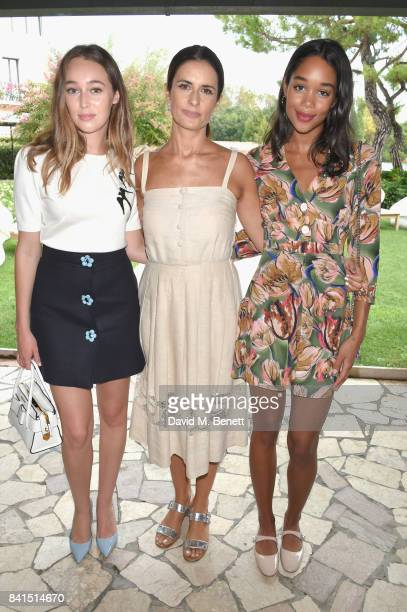 Alycia DebnamCarey Olivia Firth and Laura Harrier attend an intimate lunch hosted by Livia Firth Carlo Capasa and Caroline Scheufele to announce...