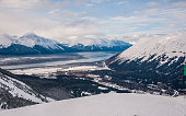 Alyeska Winter Wonderland Dramatic View of the winter scene at Alaska's best ski resort. Alyeska. the town of Girdwood below in the valley waiting for some down time after skiing