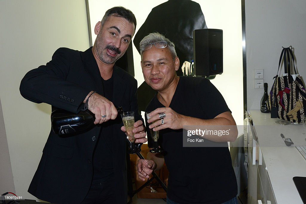 DJ Alyotis and DJ Tekyes Mika perform at the Baldinini Shop Cocktail during the Vogue Fashion Night Out on Rue Saint Honore on September 17, 2013 in Paris, France.