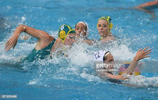 Alys Williams of The United States holds the ball during the Women's Water Polo Quarter final match against Australia on day eleven of the Budapest...