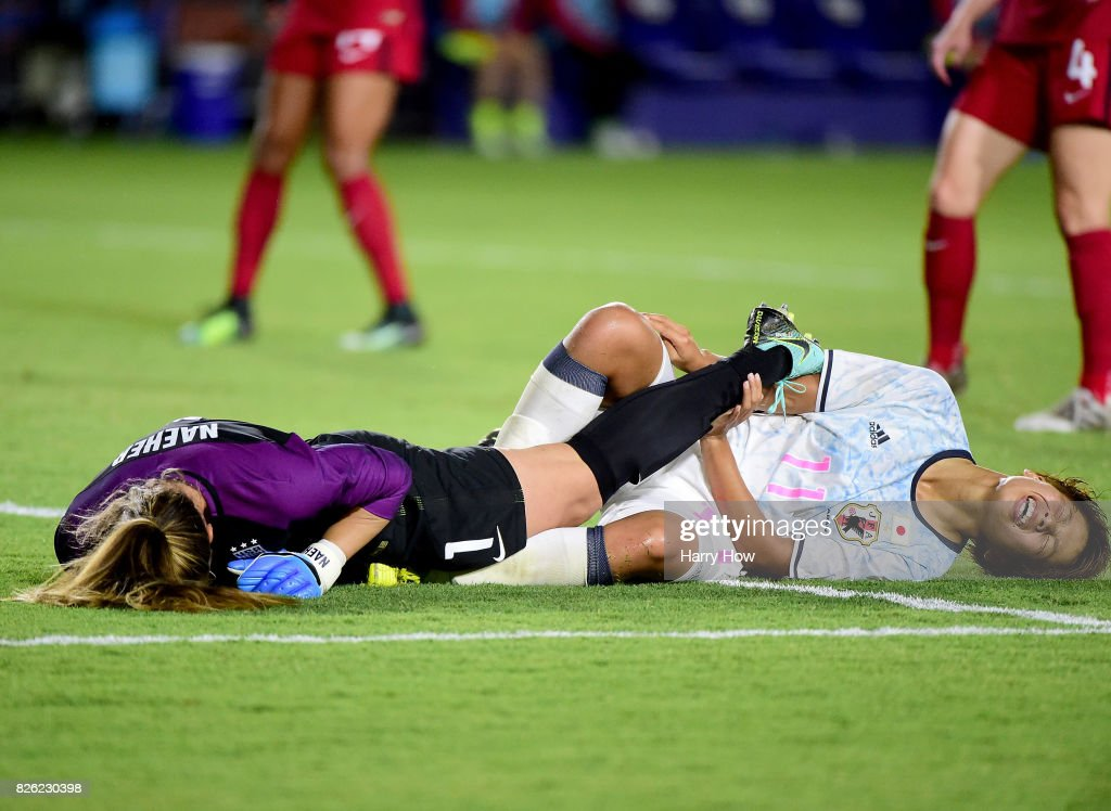 Alysa Naeher #1 of the United States and Mina Tanaka #11 of Japan react to their collision during a 3-0 United States win over Japan in the 2017 Tournament Of Nations at StubHub Center on August 3, 2017 in Carson, California.