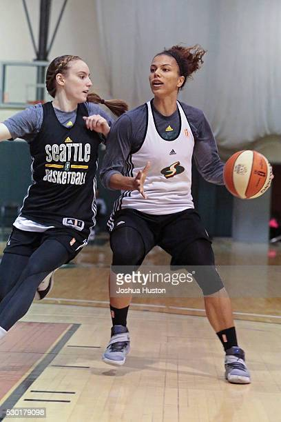 Alysha Clark drives to the basket while guarded by Blake Dietrick of the Seattle Storm during an all access practice event at Key Arena in Seattle...