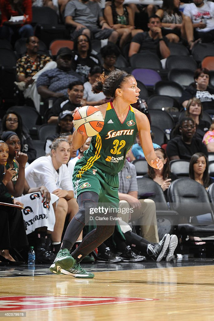Alysha Clark #32 of the Seattle Storm drives against the San Antonio Stars at the AT&T Center on July 11, 2014 in San Antonio, Texas.