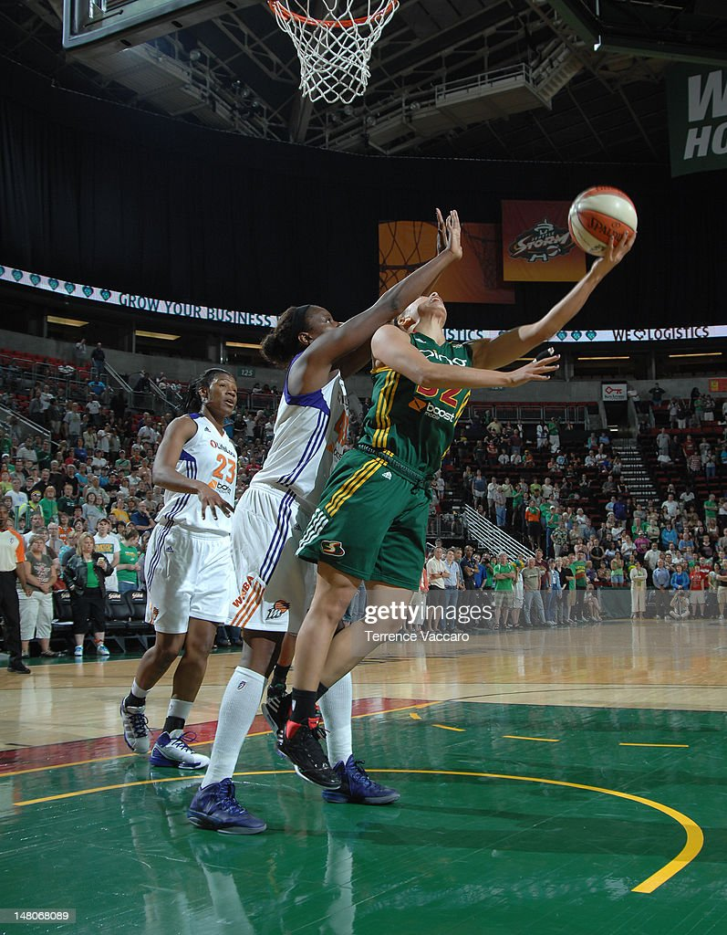 Alysha Clark of the Seattle Storm goes to the basket against Nakia Sanford of the Phoenix Mercury during the game on July 8 2012 at Key Arena in...