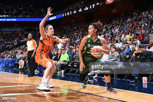 Alysha Clark of the Seattle Storm handles the ball against Kelly Faris of the Connecticut Sun on June 10 2016 at Mohegan Sun Arena in Uncasville...