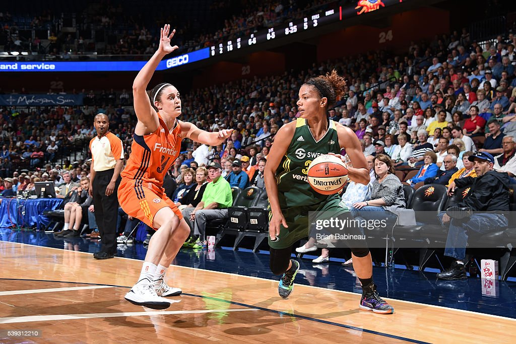 Alysha Clark #32 of the Seattle Storm handles the ball against <a gi-track='captionPersonalityLinkClicked' href=/galleries/search?phrase=Kelly+Faris&family=editorial&specificpeople=5791970 ng-click='$event.stopPropagation()'>Kelly Faris</a> #34 of the Connecticut Sun on June 10, 2016 at Mohegan Sun Arena in Uncasville, Connecticut.