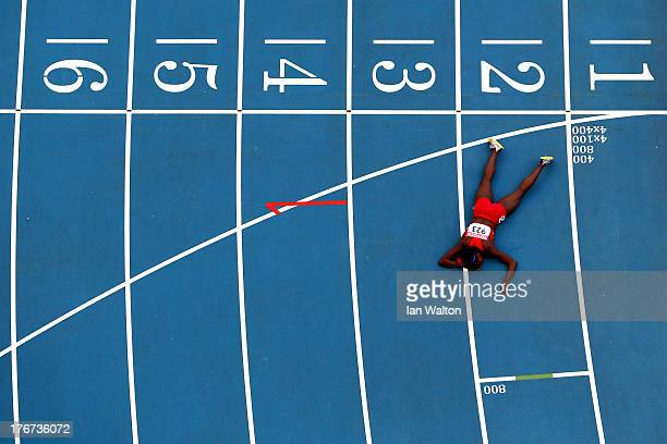 Alysia Johnson Montano of the United States lies on the track after falling at the finish line in the Women's 800 metres final during Day Nine of the...