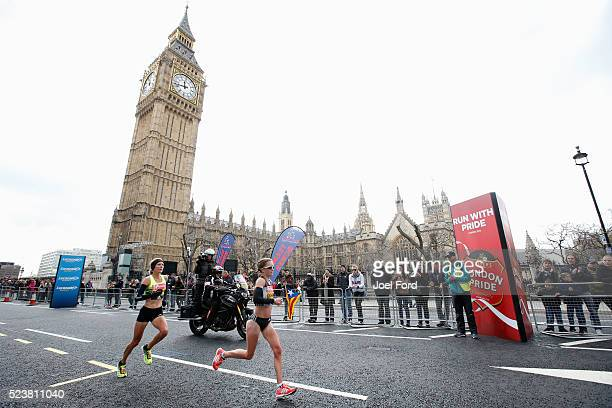 Alyson Dixon and Sonia Samuels of Great Britain race past Big Ben during the Virgin Money London Marathon on April 24 2016 in London England