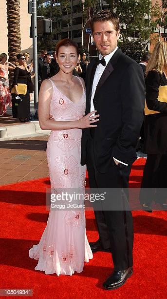 Alyson Hannigan Alexis Denisof during 2002 Creative Arts Emmy Awards Arrivals at Shrine Auditorium in Los Angeles California United States