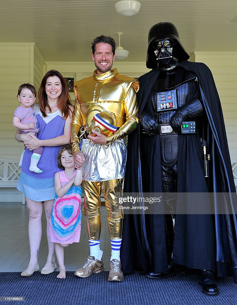 <a gi-track='captionPersonalityLinkClicked' href=/galleries/search?phrase=Alyson+Hannigan&family=editorial&specificpeople=206497 ng-click='$event.stopPropagation()'>Alyson Hannigan</a> and <a gi-track='captionPersonalityLinkClicked' href=/galleries/search?phrase=Alexis+Denisof&family=editorial&specificpeople=817794 ng-click='$event.stopPropagation()'>Alexis Denisof</a> and kids poses with Star Wars character Darth Vader at the Course Of The Force 2013, An Epic Lightsaber Relay, Benefiting Make-A-Wish Foundation at Skywalker Ranch on July 9, 2013 in San Francisco, California.
