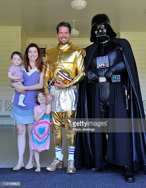 Alyson Hannigan and Alexis Denisof and kids poses with Star Wars character Darth Vader at the Course Of The Force 2013 An Epic Lightsaber Relay...