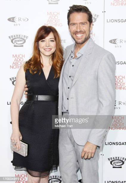 Alyson Hannigan and Alexis Denisof arrive at the Los Angeles screening of 'Much Ado About Nothing' held at Oscars Outdoors on June 5 2013 in...