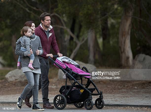Alyson Hannigan and Alexis Denisof with daughter Satyana Denisof are seen on November 12 2013 in Los Angeles California