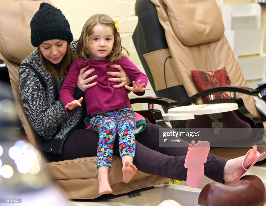 <a gi-track='captionPersonalityLinkClicked' href=/galleries/search?phrase=Alyson+Hannigan&family=editorial&specificpeople=206497 ng-click='$event.stopPropagation()'>Alyson Hannigan</a> and Satyana Denisof are seen on January 7, 2013 in Los Angeles, California.