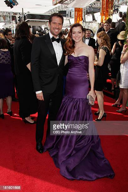 Alyson Hannigan from How I Met Your Mother and husband Alexis Denisof on the red carpet for the 65th Primetime Emmy Awards which will be broadcast...