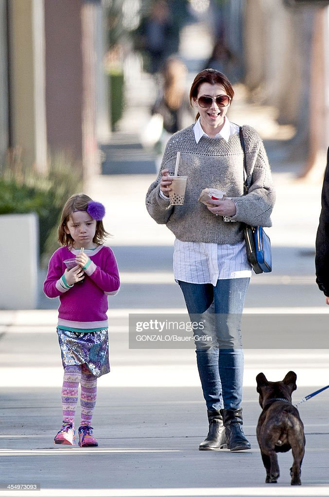 <a gi-track='captionPersonalityLinkClicked' href=/galleries/search?phrase=Alyson+Hannigan&family=editorial&specificpeople=206497 ng-click='$event.stopPropagation()'>Alyson Hannigan</a> is seen picking up her daughter, Satyana Denisof from school on December 10, 2013 in Los Angeles, California.