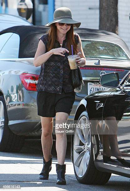 Alyson Hannigan wears a floppy hat as she gets out of her car in Santa Monica on September 13 2013 in Los Angeles California