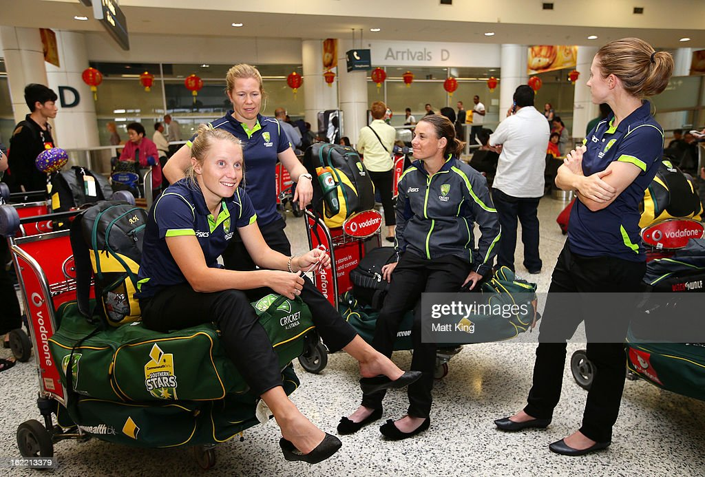 Alyssa Healy, <a gi-track='captionPersonalityLinkClicked' href=/galleries/search?phrase=Alex+Blackwell&family=editorial&specificpeople=198941 ng-click='$event.stopPropagation()'>Alex Blackwell</a>, Erin Osborne and Rachael Haynes of the Australian women's cricket arrive home following their win in the 2013 World Cup at Sydney International Airport on February 21, 2013 in Sydney, Australia.