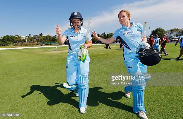 Alyssa Healy and Alex Blackwell celebrate during the WNCL Final match betwee Queensland and New South Wales at Allan Border Field on December 3 2016...