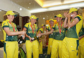Alyssa Healy and Alex Blackwell of Australia spray champagne as the Australian team celebrate in the changing rooms after winning the Final of the...