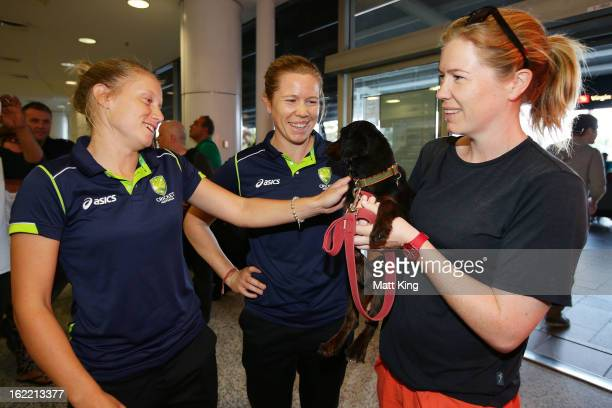 Alyssa Healy and Alex Blackwell of the Australian women's cricket team are greeted by Kate Blackwell after arriving home following their win in the...