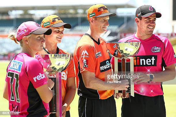 Alyssa Healy and Moises Henriques of the Sixers pose with WBBL and BBL trophies together with Suzie Bates and Adam Voges of the Scorchers during a...